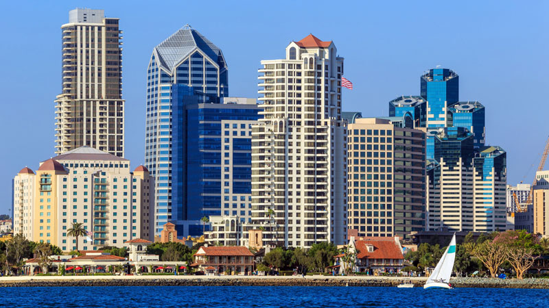 Downtown San Diego office buildings and waterfront providing remote collection services