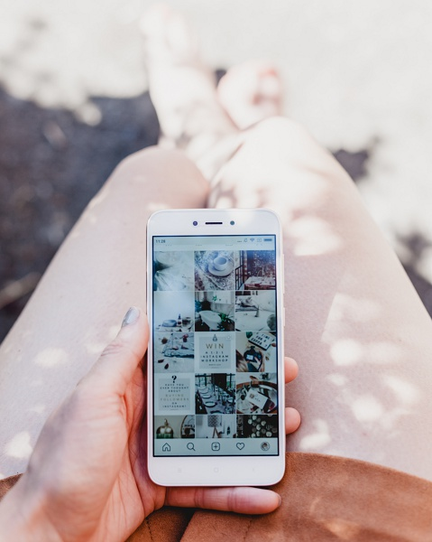 Woman looking at phone pictures